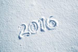 Happy new year 2016 celebration message handwritten on the sunny fresh snow. Lovely Happy new Year Holiday greeting card.