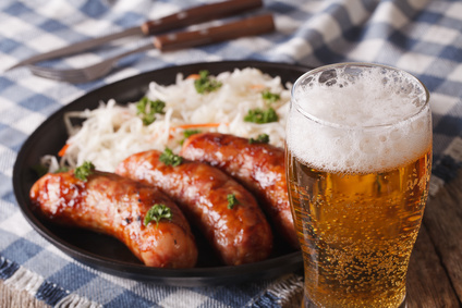 Lager beer and snacks of sausages and sauerkraut