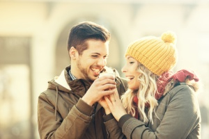 Happy Couple Having Hot Drink Outdoors