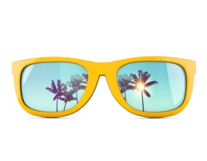 Summer sunglasses with tropical palm tree reflections.