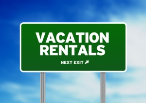 Green Road Sign - Vacation Rentals